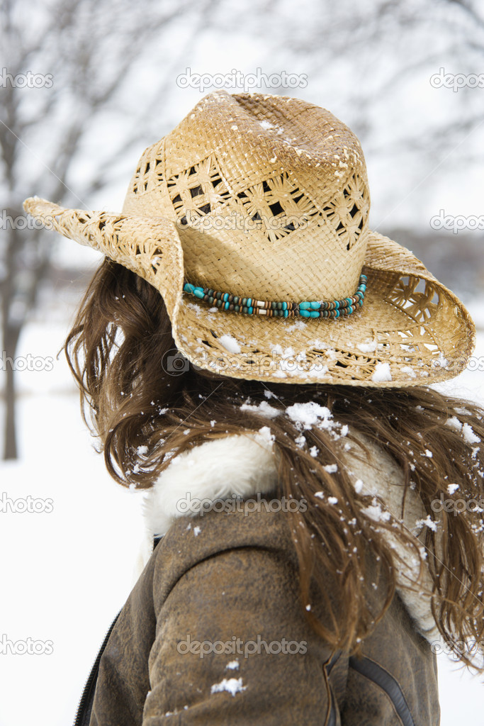 Woman in cowboy hat.