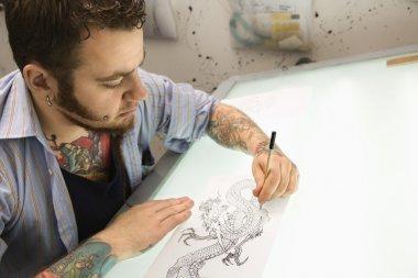 Tattoo artist.