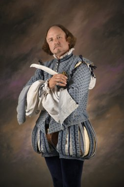 Shakespeare with quill pen.