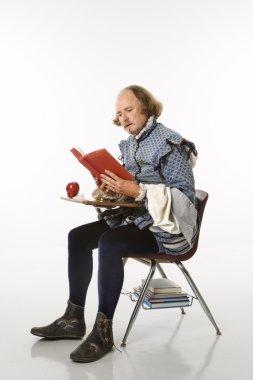 Shakespeare in school desk.