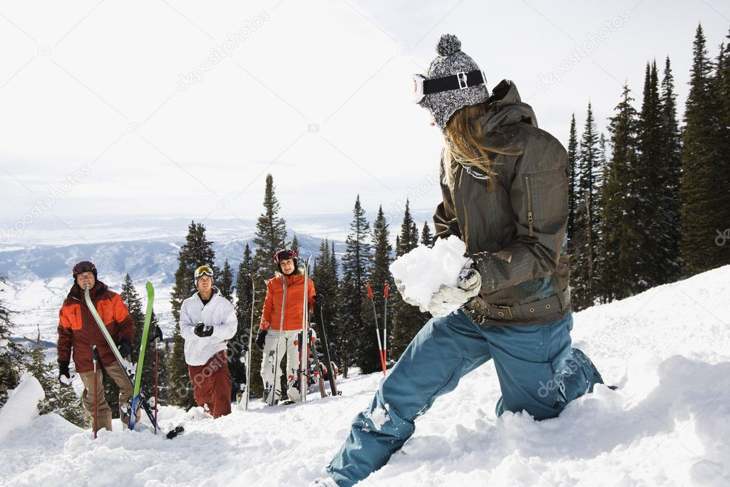 Female Skier with Snowball