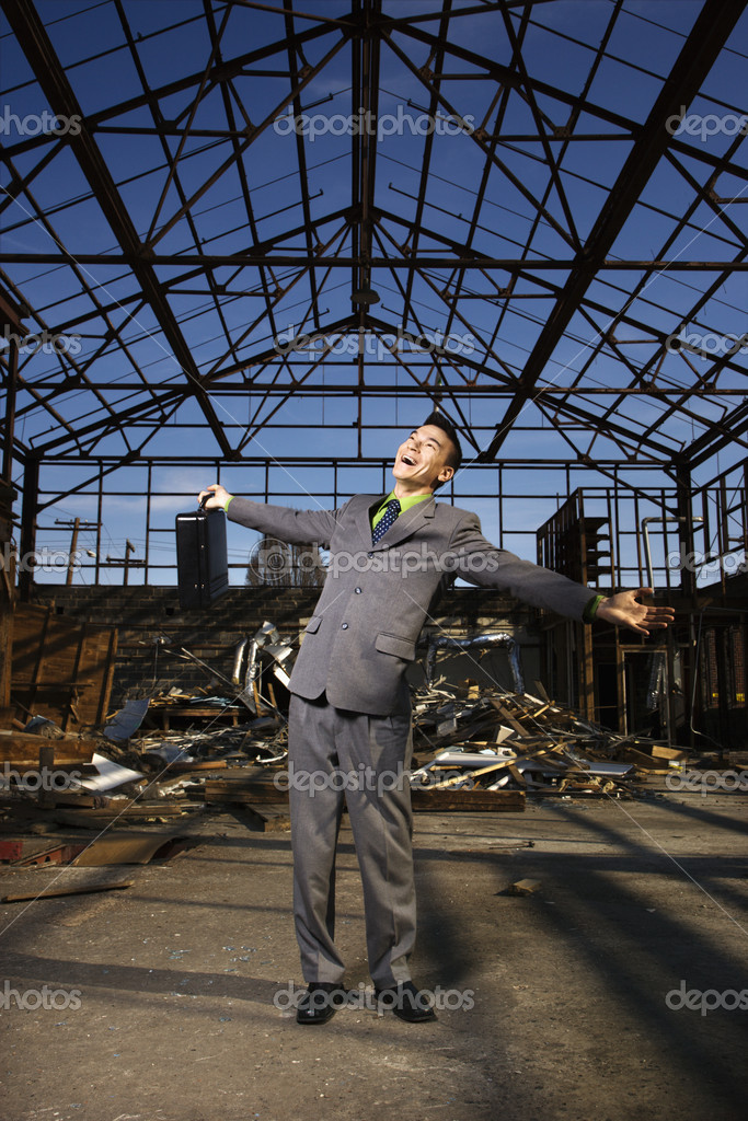 Young Businessman Smiling With Arms Open