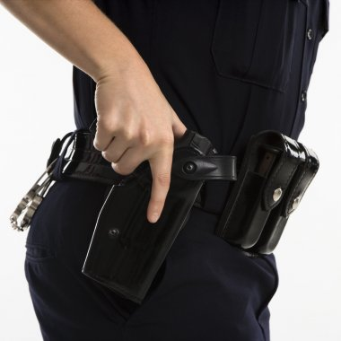 Armed policewoman.