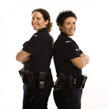 Policewomen back to back.