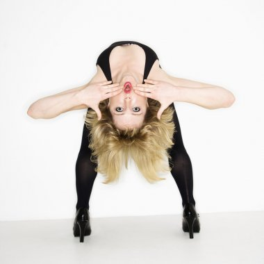 Woman bending over backwards.