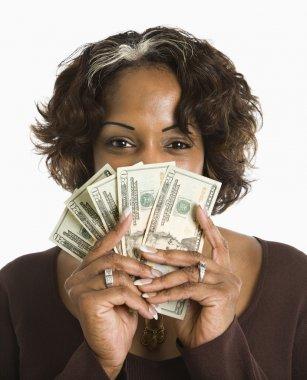 Woman holding cash.