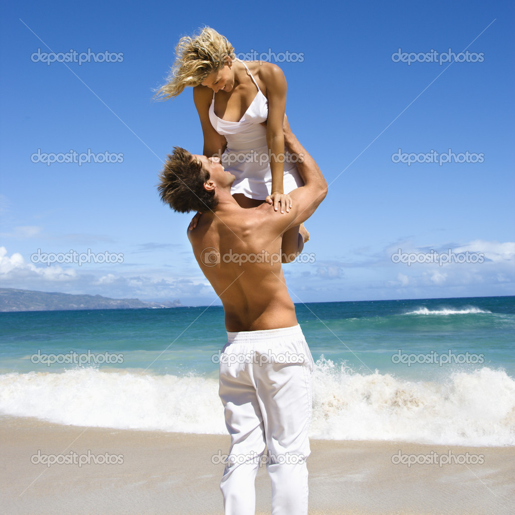 Man holding woman.