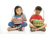 Fotografie Children with Easter baskets.