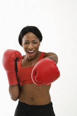 Woman boxer punching.