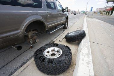 Broken down vehicle on road.