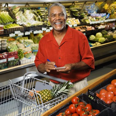 Man grocery shopping.