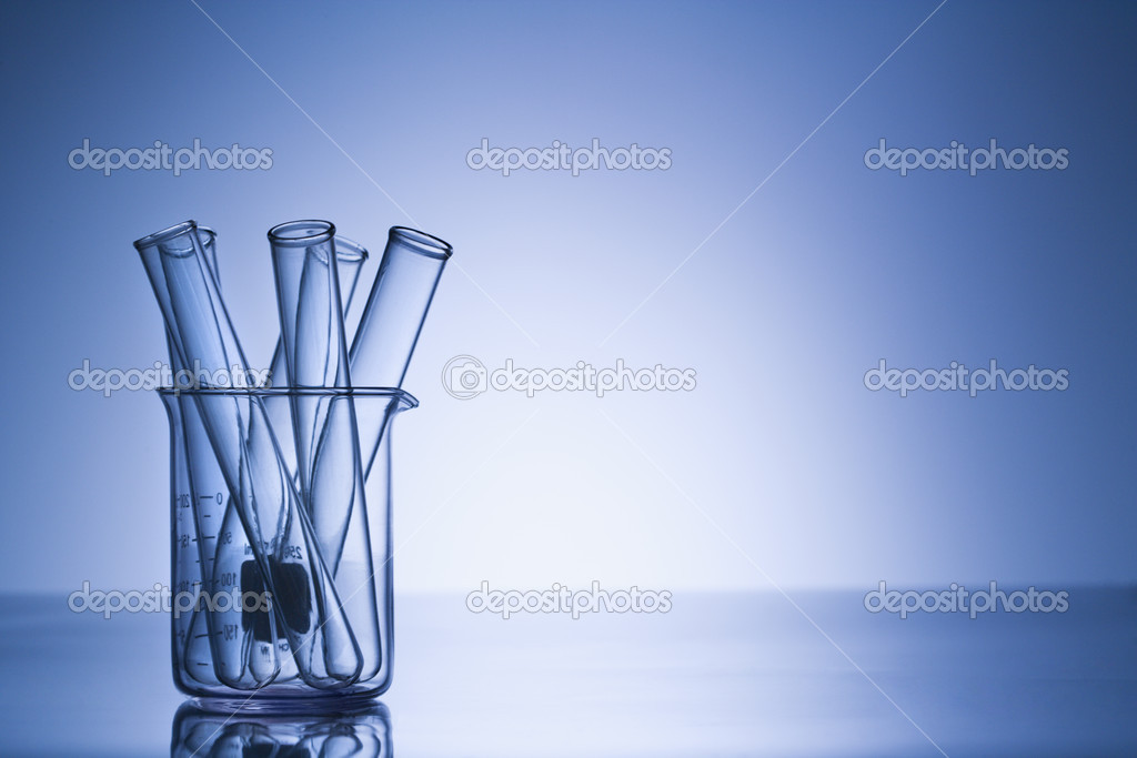 Test tubes in glass beaker with blue tint.