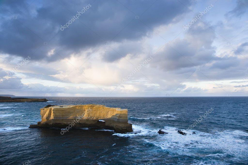 Rock formation in ocean.