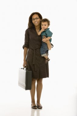 Business mom with child.