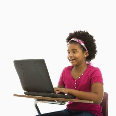 Schoolgirl on laptop.