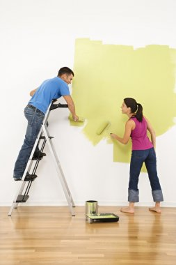 Couple painting house.