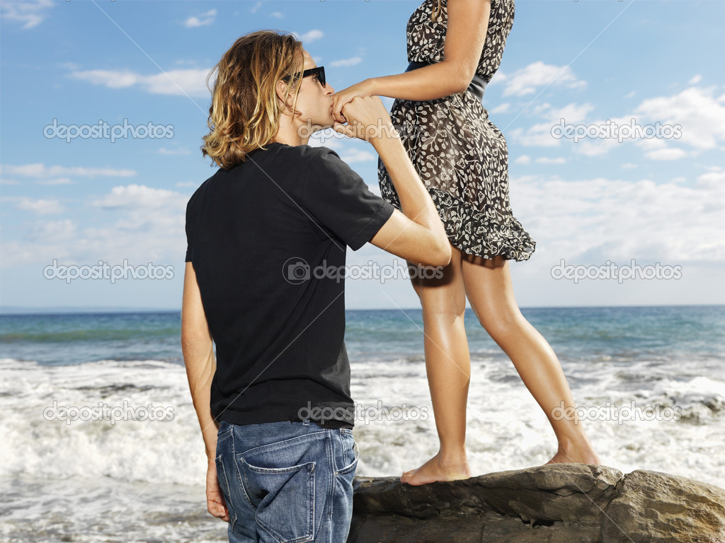 Young Man Kissing Womans Hand
