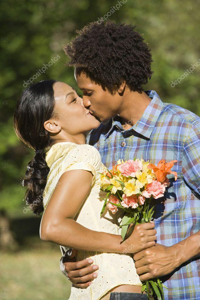 Couple kissing.