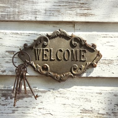 Welcome sign on wall.