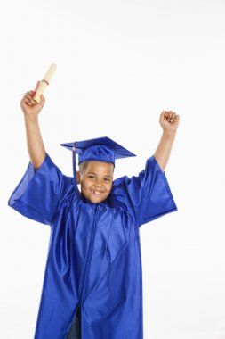 Young hispanic boy graduate.