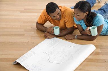 Couple looking at blueprints.