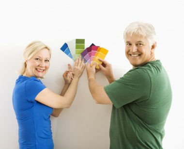 Man and woman comparing swatches.
