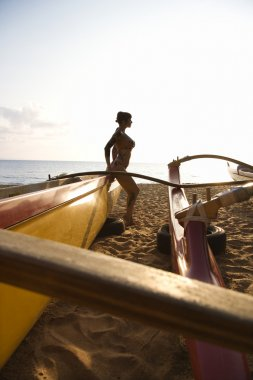 Woman with outrigger.