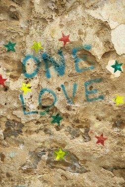 Graffiti on rock wall.
