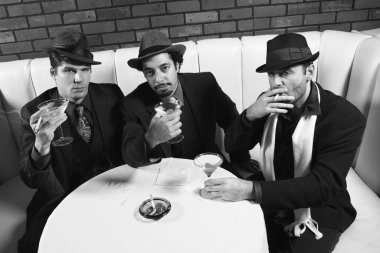 Three retro gangsters.