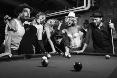 Retro group playing pool.