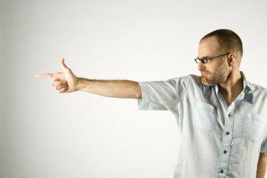 Man holding hand like gun.