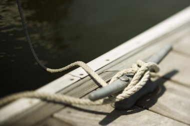 Rope tied to boat dock.
