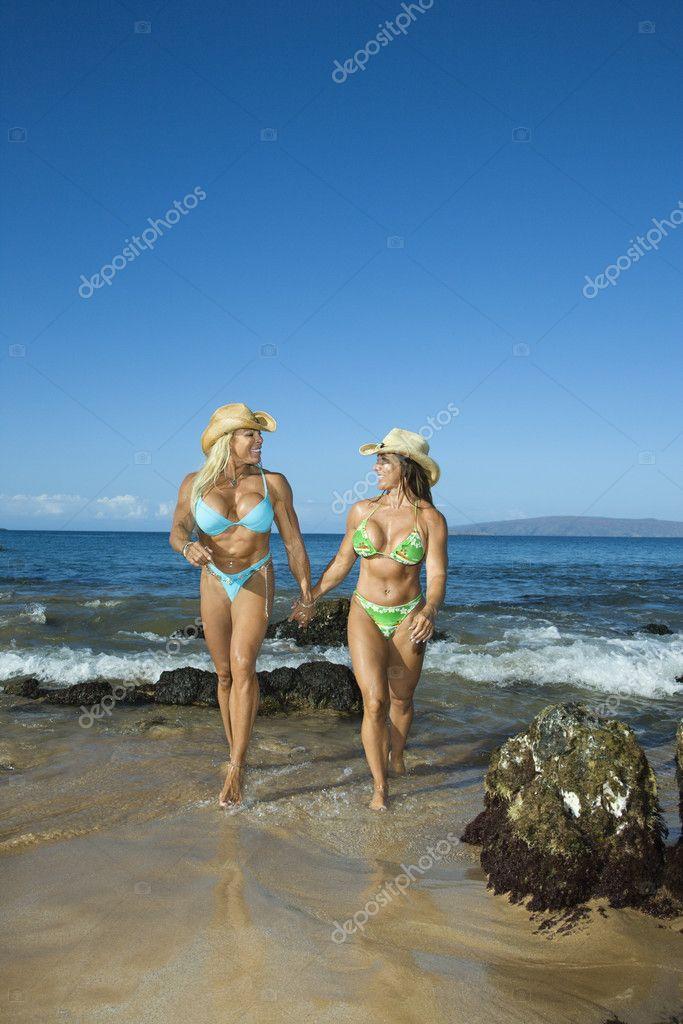 Bodybuilders at beach.