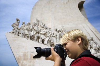 Boy photographing.