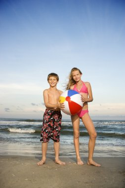Boy and girl on beach.