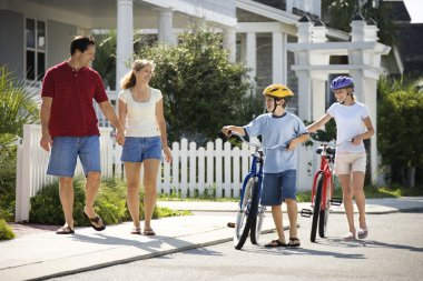 Family Walking with Bicycles