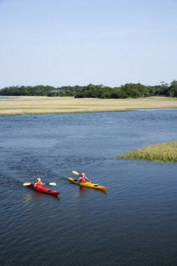 Teen boys kayaking.