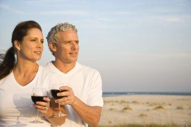 Couple Drinking Wine on Beach