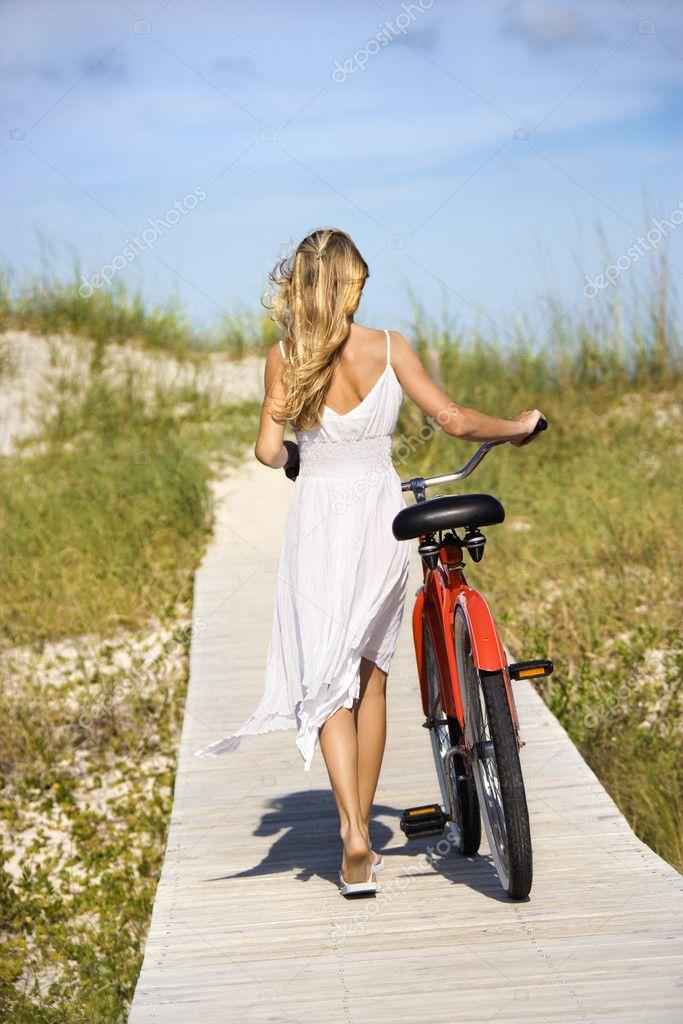 Girl Walking Bike on Boardwalk