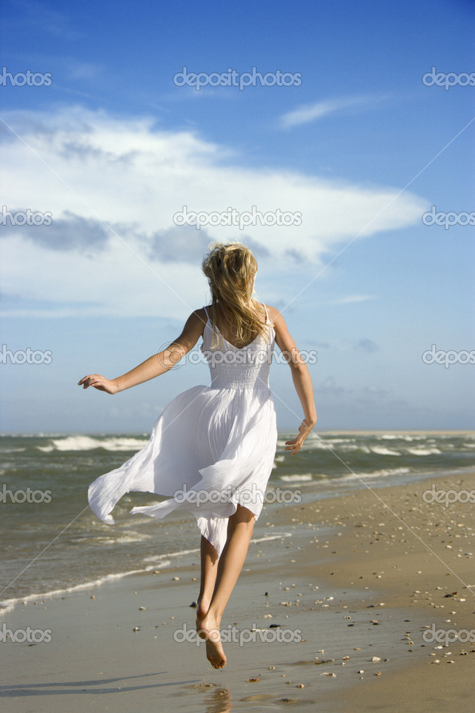 Girl running down the beach.
