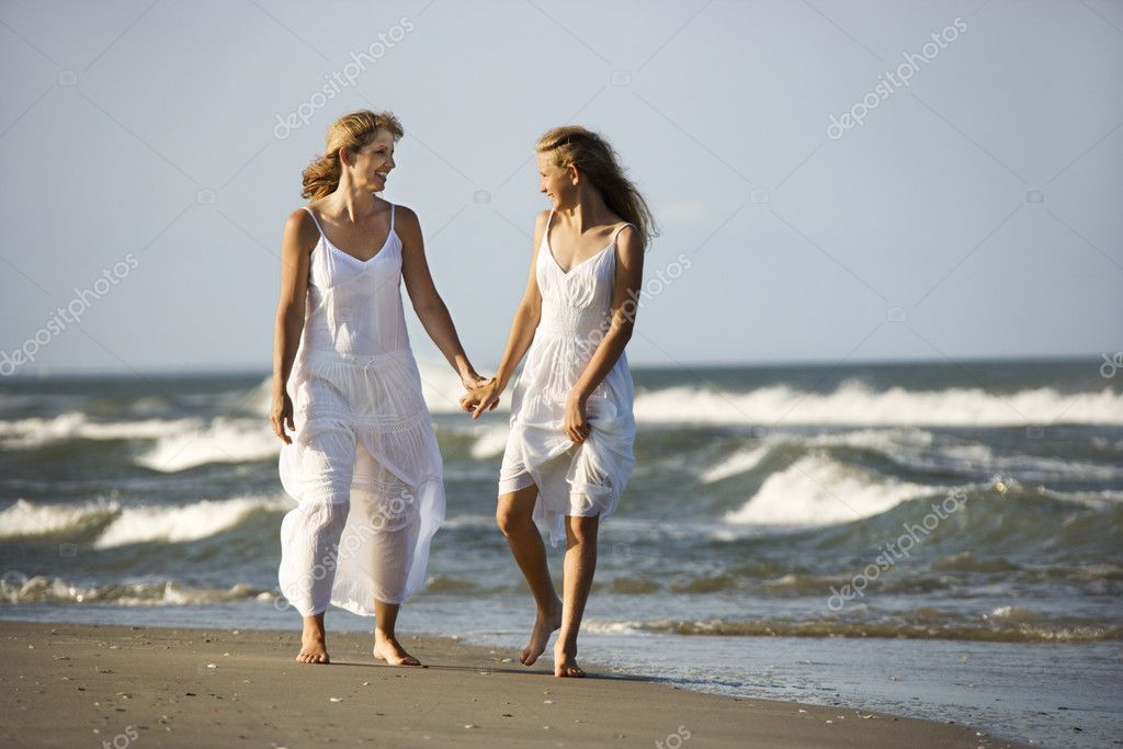 Mother and daughter on beach.
