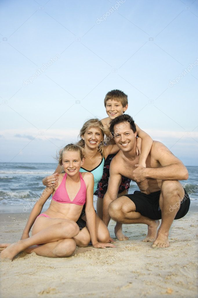 Smiling happy family on beach.