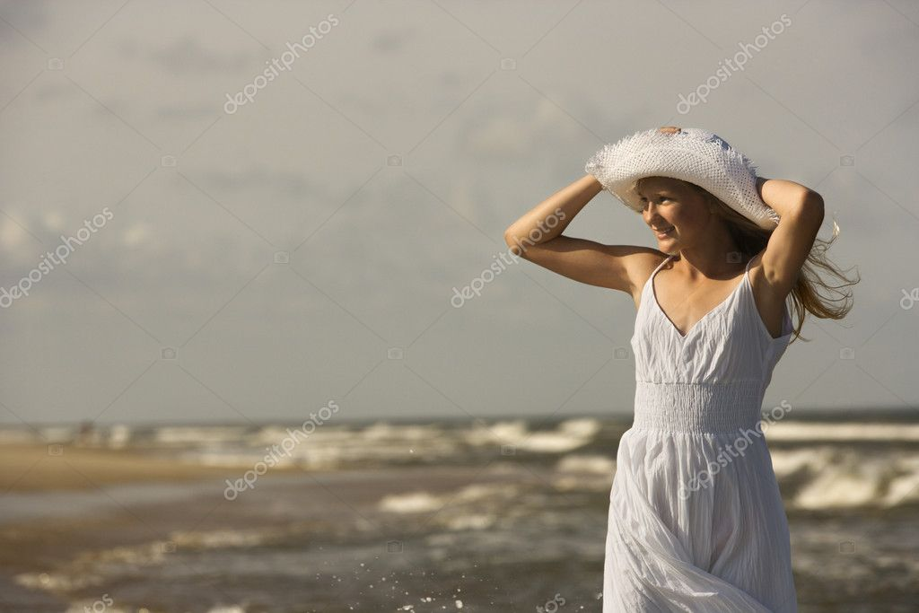 Girl on windy beach.