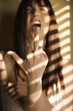 Woman giving middle finger.