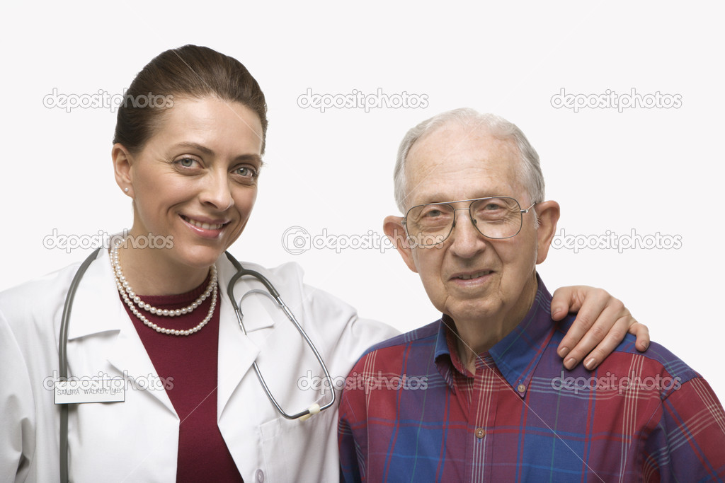 Mid-adult Caucasian female doctor with arm around elderly Caucasian male.