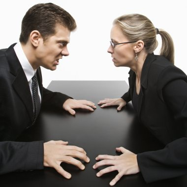 Caucasian mid-adult businessman and woman staring at each other with hostile expression. stock vector