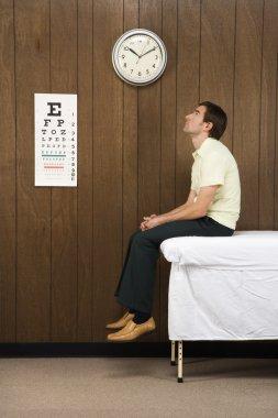 Patient in medical room.