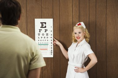 Nurse and eye chart.