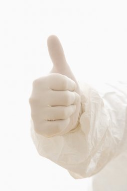Hand wearing white rubber glove giving the thumbs up signal. stock vector