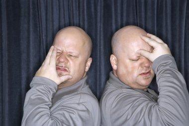 Identical twin men.